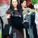 Elegant woman shopping in retail store — Stock Photo