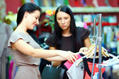 Pretty women shopping in retail store — Stock Photo