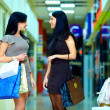 Happy elegant women shopping in city mall — Stock Photo