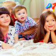 Group of cute children listen attentively — Stockfoto
