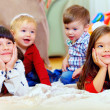 Group of attentive kids in nursery room — Foto Stock