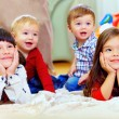 Group of attentive kids in nursery room — Stok fotoğraf
