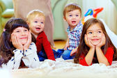 Group of attentive kids in nursery room — Stock Photo