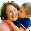 Happy grandma with grandson embracing outdoor — Stock Photo #19646163