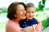 Happy grandmother with grandson having fun outside — Stock Photo