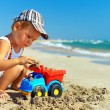 Cute baby boy playing toys on beach — Stock Photo #19722883
