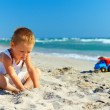 Cute baby boy playing on the beach — Stock Photo