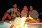 Happy friends having fun around the bonfire — Photo
