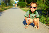 Stylish boy in sunglasses, summer outdoors — Stock Photo