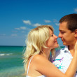 Young couple in love kissing on beach — Stock Photo