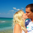Royalty-Free Stock Photo: Young couple in love kissing on beach