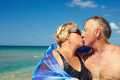 Middle aged couple kissing on the vacation — Stock Photo