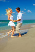 Happy couple in love having fun on the beach — Stock Photo