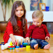 Beautiful brother and sister playing at home — Stock Photo #20001837