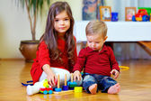 Beautiful brother and sister playing at home — Stock Photo