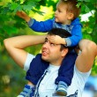 Stock Photo: Father and son spending time together outdoors