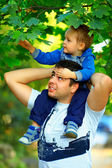 Father and son spending time together outdoors — Stock Photo