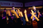 Youth waving hands on concert in night club — Stock Photo