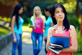 Colorful portrait of thoughtful female student — Stock Photo