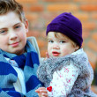 Outdoor portrait of cute brother and sister — Stock Photo #20406177