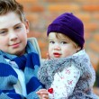 Stock Photo: Outdoor portrait of cute brother and sister