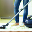 Woman cleaning home with vacuum cleaner — Stock Photo