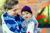 Outdoor portrait of cute brother and sister — Stock Photo