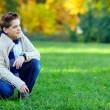 Stylish teenage boy on green meadow — Stock Photo #20503603