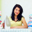 Happy housewife completed ironing, home interior — Stock Photo