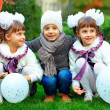 Playful twin girls and boy entertain in colorful park - 
