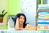 Tired woman after ironing clothes, home interior — Stock Photo