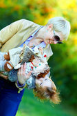 Happy mother and baby having fun in colorful park — Stock Photo
