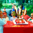 Happy kids around birthday cake — Stock Photo #21316069