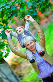 Happy mother and baby girl having fun in colorful park — Stock Photo