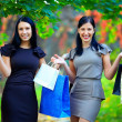 Royalty-Free Stock Photo: Beautiful elegant women after shopping, colorful outdoors