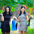 Two happy laughing women after shopping — Stock Photo