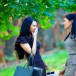 Two beautiful women talking in colorful park — Stock Photo