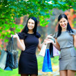 Beautiful elegant women after shopping, colorful outdoors — Stock Photo