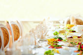 Set table in luxury restaurant — Stock Photo