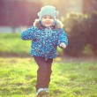 Stock Photo: Happy baby boy running sunlit spring park