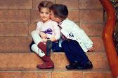 Little gentleman kisses girl — Stock Photo