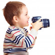 Stock Photo: Happy child photographer with DSLR camera, isolated