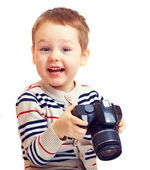Happy child photographer with DSLR camera, isolated — Stock Photo