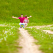 Father and baby having fun, playing on green field — Stock Photo #25072115