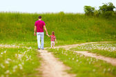 Father and son walking rural footpath — Стоковое фото