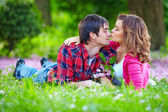 Young tender couple in spring park — Stock Photo