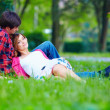 Tender young couple relaxing on spring meadow — Stock Photo