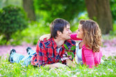 Beautiful happy couple in summer park — Stock Photo
