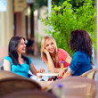 Happy friends talking in summer cafe, urban outdoors — Stock Photo #25954453