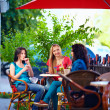 Young female friends sitting on cafe terrace, urban outdoors — Stock Photo #25954479